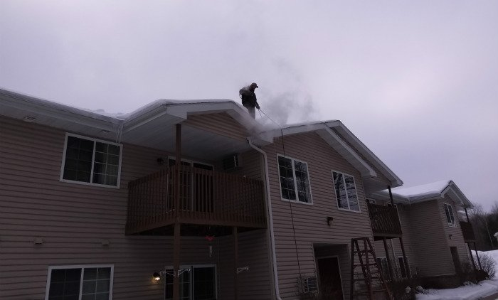 Roof Ice Dam Steaming on Apartment Building